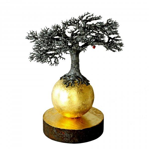 Träd på guldkula